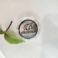 Монеты Skamol
